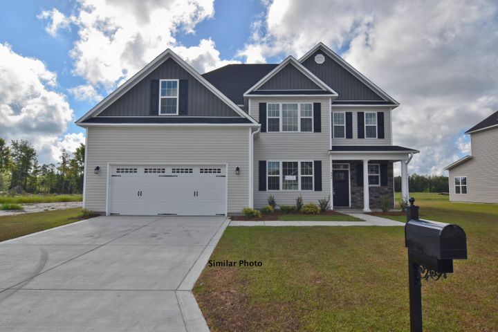 Welcome to the highly desired and popular community of Onslow Bay. Brand new construction built by Onslow County's most trusted and preferred builder, featured in Builder 100/ Top 200 Builders in the country. Onslow Bay is a hot spot, 3 miles to MCB Camp Lejeune's Piney Green gate, 14 miles to New River Air Station and minutes to area schools, shopping and dining. This beautiful neighborhood is sure to impress, complete with a clubhouse area and community poolIntroducing the Laura 3307 floor plan which features 5 bedrooms, 2 of which are master suites, and 4.5 bathrooms at approximately 3307 heated square feet. The exterior is charming with easy-to-maintain vinyl siding, accented by stone or brick. . The quaint front porch is waiting for your hanging baskets. All surrounded by a sodded front yard with a clean, classic landscape. The grand, 2-story foyer makes a great first impression.  Host those special occasions in the formal dining room. The chef in the family is sure to fall in love with the kitchen! Flat panel, staggered cabinets, an island, and stainless appliances to include a smooth-top range, microwave hood, and dishwasher. Enjoy your morning coffee in the breakfast nook! The expansive family room, approximately 22'x15' features a ceiling fan ideal for cooling off during those hot Carolina summers or snuggle up to the cozy electric fireplace, surrounded by marble and topped with a custom mantle. The first floor master suite with walk-in-closet and master bathroom are the perfect place for guests who want privacy! The main master suite is located upstairs at approximately 19'x15' with an additional 11'x14' sitting area, walk-in-closet, trey ceiling, and ceiling fan. Unwind after a long day in the luxurious master bathroom. Double vanity topped with cultured marble counters, full view custom mirror, ceramic tile flooring, separate shower, and soaking tub. Bedrooms 3, 4, and 5 are perfectly sized and each with their own walk-in-closet! Chores are made easier w