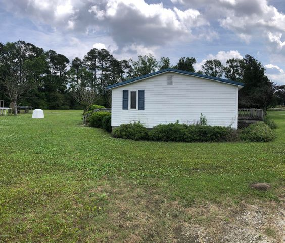 Country living just a  few miles outside of Beulaville. Get to either Jacksonville or I40 with a short drive. Large front and back decks to enjoy. One open bay outbuilding and lean-to.  Updated roof and siding from original.