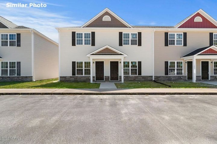 A unique opportunity awaits in the heart of Beulaville! These beautiful NEW 2 bedroom / 2.5 bathroom townhomes have so much to offer. As you walk in the front door, you will notice the open concept with the living area opening up to the kitchen. The eat in kitchen offers a stainless steel dishwasher, oven, and microwave hood along with plenty of cabinet space. The laundry room is tucked away as well as the half bath in the living area for your guests to enjoy. Upstairs you will find two bedrooms, both having their own full bathroom and closet. Out back enjoy a covered patio with an attached storage closet. Cornerstone Village is walking distance to grocery stores and shopping as well! Be sure to schedule your showing today because these will not last long!