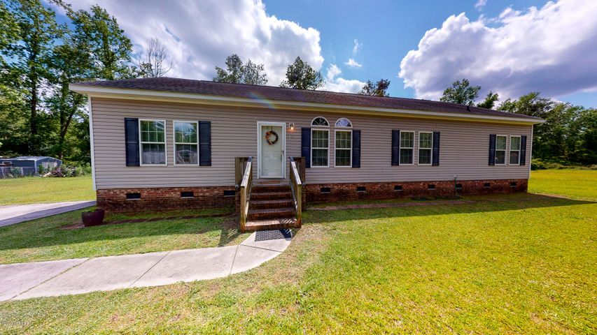 This well maintained 4 bedroom Modular home is situated on a 1.1 lot just off Pickett Rd. in unincorporated Jacksonville. It features a split floor plan and open-concept that allow for space and separate living areas. The large open corner lot allows for a great space for children to play or to add a garage. The lot is surrounded by privacytrees that buffer the house and give it great character. This is a great home for a young growing family or someone seeking space in the county without an HOA or city taxes. All this with a great commuting distance to all the installations.