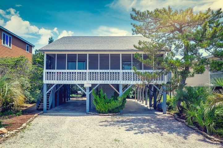 You can make this your beach home and it makes a terrific rental property too!! Large open living, dining, kitchen area that opens to a 10x32 screened porch is perfect for large family/friend gatherings...all within walking distance to the beach! Well maintained with exterior vinyl siding, replacement windows, updated HVAC, and brand new stove & refrigerator. Main level also has 2 bedrooms, full bath & laundry room. And upstairs has a large master bedroom, full bath and a spacious, open loft that can either be a 4th bedroom area or additional living space. Sold furnished and ready for you to enjoy!