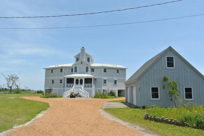 Looking for a secluded beach front home to enjoy your weekends with family & friends? Look no further! This stunning waterfront home has everything you've been looking for! Features include open floor plan with cozy living room that flows into the dining area with 2 story length windows overlooking the water. Upgraded kitchen w/tile floor, granite counter tops, tile back splash, all appliances & beautiful cabinets. 2 Large sized bedrooms on 1st floor & each have private bathroom. Sizable mud/laundry room off of master bath. 2nd floor features a long loft area that overlooks the 1st floor. Has 2 large rooms that are ideal for play or craft room & each have private porch. Each have private master bath. 3rd floor offers a panorama birds eye view of the area with endless water views from every side & private porch. Features include screened-in back porch overlooking driveway, molding w/rope detail through house, metal roof, 160 ft wood dock & boat lift installed 2020, generator, hurricane shutters, massive back porch overlooking the water front, detached 2 car garage w/loft area, 36 x 20 RV/boat building.