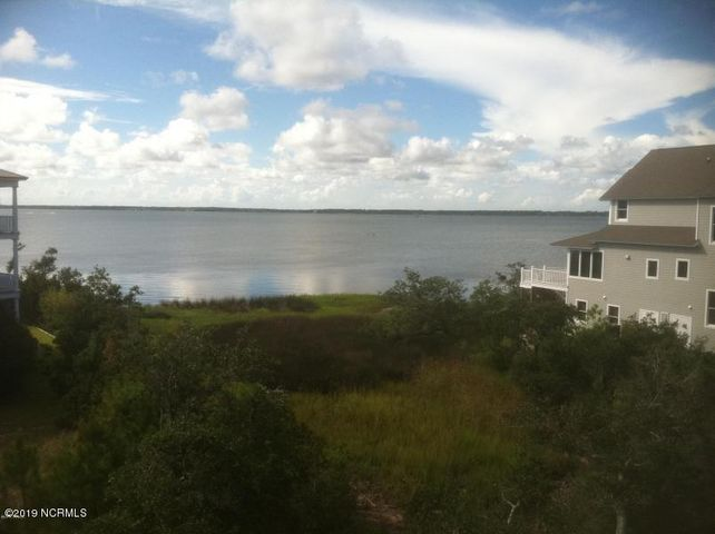 Incredible lot in Sea Isle Plantation North -- this site also conveys with Boat Slip #57 in the private and protected Sea Isle Marina. The views from this site will be fabulous and the amenities offered at Sea Isle Plantation are some of the best on the Island: private swimming pool, marina with easy access to Bogue Sound, tennis courts and a golf-cart friendly community.  ''Sound Front'' views and a deep water boat slip! This lot is ready for you to build your dream home and enjoy Island living at its best!