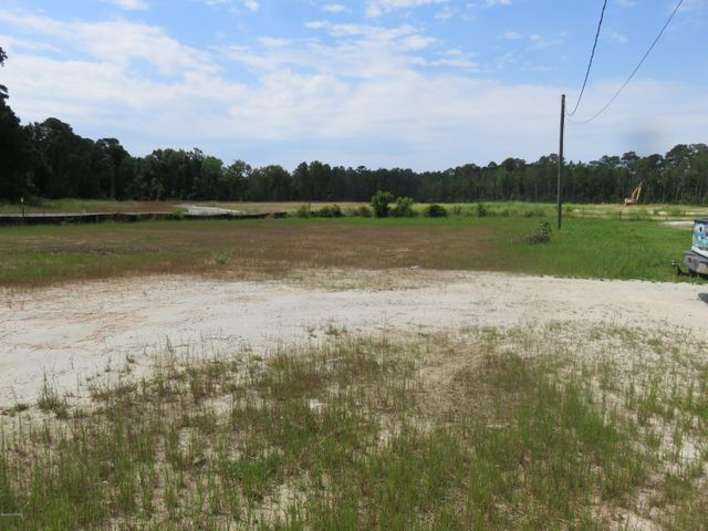 Cleared commercial lot zoned B-1 located in prime area of Swansboro near Wal-Mart. Lot is .45 acres right beside Swansboro Pawn and in front of Swansboro's newest townhome subdivision being built now. Great spot for office space, small business with Town of Swansboro approval.