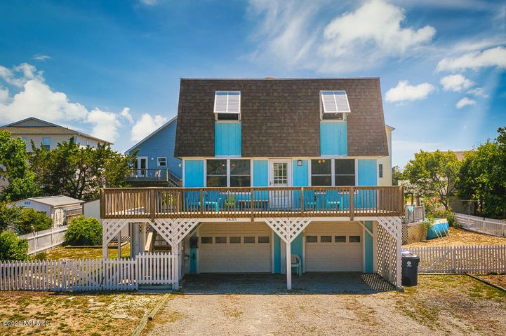 Enjoy a quiet, west beach location on Oak Island with 4 bd/2 bath with a pool.  Park your boat/car/golf cart and bikes in the oversized two car garage.  This Bahamas style home has an oversized lot that is fenced. Outdoor living includes a fire pit and grill for family memories next to the pool area.  The location is steps away from the 39th street public kayak/boat launch and only 2 blocks directly to the beach access. Includes a shed for storage & outside shower. Enjoy the newly renovated kitchen and water views of the Davis Canal from the large deck. The home is currently an Airbnb rental with revenues of 23k in 19 and projected revenues of appx 30k in 20. The furnishings are included and recently upgraded. Recently painted inside and out for low maintenance and ready to go!Owner is Broker.