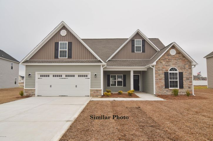 Welcome to the highly desired and popular community of Onslow Bay. Brand new construction built by Onslow County's most trusted and preferred builder, featured in Builder 100/ Top 200 Builders in the country. Onslow Bay is a hot spot, 3 miles to MCB Camp Lejeune's Piney Green gate, 14 miles to New River Air Station and minutes to area schools, shopping and dining. This beautiful neighborhood is sure to impress, complete with a clubhouse area and community pool.Introducing the Hickory floor plan featuring 3 bedrooms and 3 full bathrooms at approximately 2,223 heated square feet. Charming exterior with easy-to-maintain vinyl siding, accented by stone or brick. All surrounded by a sodded front yard with a clean, classic landscape. The foyer welcomes you in, opening to the formal dining room. Host those special occasions in this picture perfect room. The kitchen features flat panel, staggered cabinets, and a cozy breakfast nook. Stainless appliances include a smooth-top range, microwave hood, and dishwasher. The master suite is approximately 15' x 13' with a huge walk-in closet, an alluring tray ceiling and ceiling fan. ''Get away from it all'' in the luxurious master bathroom. Double vanity topped with cultured marble counters, full view custom mirror, ceramic tile flooring, separate shower and soaking tub. Bedrooms 2 and 3 are perfectly sized. Upstairs is the bonus room/ 4th bedroom with a large walk in closet and the third full bathroom. Separate laundry room leads to the 2 car garage. Covered patio. All backed by a one-year builder warranty from a top, local builder. Call today. NOTE: Floor plan renderings are similar and solely representational. Measurements, elevations, and design features, among other items may change in the final construction. Call to verify. Welcome Home.