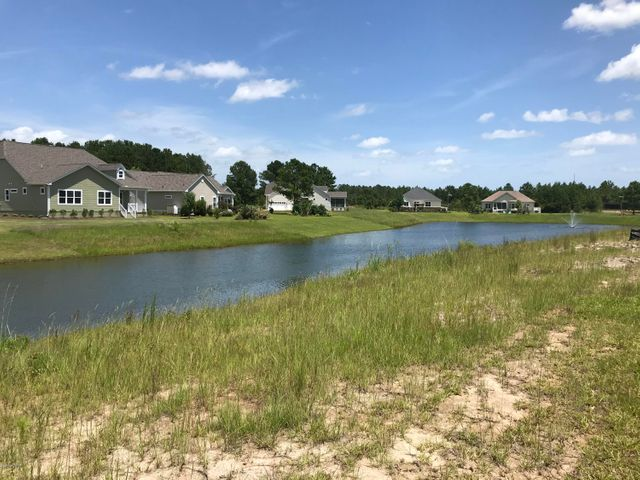Have you been looking for that perfect place to build your forever home at the beach? This is it!!! Beautiful gated community of the Hamptons at Brunswick Plantation with all the amenities, plus a tranquil pond right in the back yard. And this homesite faces the perfect way to give you morning sun, and not the hot sun in the afternoon so you can enjoy your back patio for entertaining.