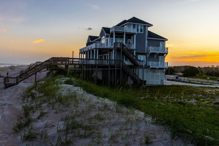 Finished 2020 with 133k in rental income- This beautifully designed with all of the luxuries you would expect in your future dream property on North Topsail Island!! The income this home brings in from owner managed rentals are unbelievable, rent most of the year and enjoy yourself for the rest of the year!! The property boasts 6 bedrooms, 5.5 bathrooms, expansive decks from all bedrooms, and direct access to the beach. On the lower level you will find multiple parking options, then head upstairs the 1st level guest suites to drop off your guests luggage, to start a load of laundry, or to rinse off after a day at the beach. The next level up is perfect for relaxation, entertaining, or dining in the main floor kitchen/living area. All with the most beautiful backdrop of the ocean and seagulls flying through the crystal blue sky. At the end of the day walk up to the 4th level penthouse, simply drift off to sleep while  listening to the waves and coastal breeze!! As you wake up the next day be sure to watch the sunrise throughout the entire home- it is a site to remember!!