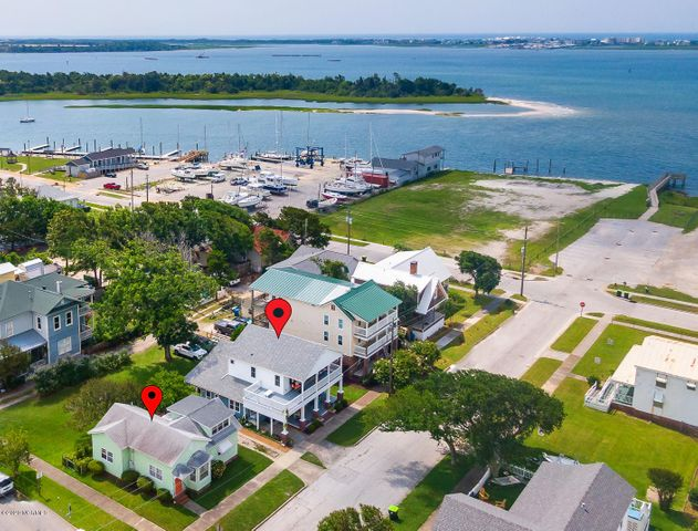 TWO complete houses on one lot!!  The combined room counts are:  13 rooms, 5 bedrooms, 4 full baths and one 1/2 bath with a total square footage of both homes added together to make 2811 square feet! Amazing opportunity to own 2 homes in downtown Morehead City near Bogue Sound: 203 S. 10th Street AND 201 S. 10th (formerly 913 Evans Street)! Perfect for family and extended family, guests or visitors. 203 S. 10th St features: 1894 square feet with 8 rooms, 3 bedrooms and 3 bathrooms (the laundry/bath area is under 7' ceiling height and not included in total square footage, but bath added to room count) this home offers great indoor and outdoor spaces with ample decking and porches. 201 S. 10th is a quaint cottage of 917 square feet offering 5 rooms, 2 bedrooms, 1.5 baths and a large finished attic space. Please see floorplans for both homes under documents. This location is also near the recently improved Shevans Park on 15/16th St with tennis courts, a large playground and a picnic shelter; the 16th Street sound access with a sandy beach; the 10th St Boat Ramp which has parking, sandy beach and pier/docks; the Walter Lewis Park at the end of 12th St offers water access and picnic areas. The Downtown Waterfront area for shopping, restaurants and the Morehead City charter fishing fleet is within an easy bike ride or stroll down the sidewalks. Make these coastal cottages your new home or home away from home!