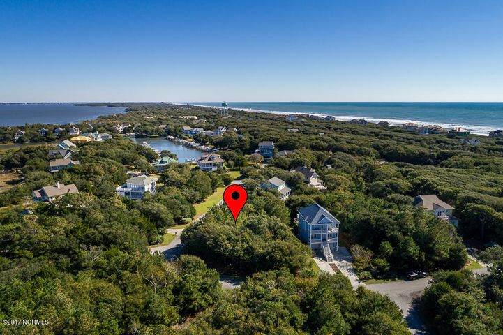 Great Building lot in Sea Isle Plantation which also includes a Boat Slip (#12) and a 14,000 lb Lift in the private and protected Sea Isle Marina! Boat slip conveys with the lift already in place. The amenities offered at Sea Isle are some of the best on the island: swimming pool, marina, tennis courts, ocean access, golf-cart friendly community. This site is ready for you to build your dream home and enjoy island living at its finest!!!