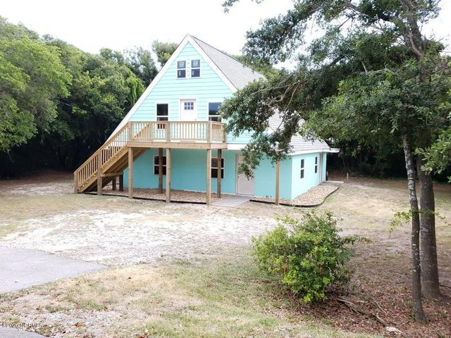 FOURTH ROW OCEAN SIDE!! Over 2000SF! Hear the ocean at night! 3 minute walking distance to the surf! Duplex FIXER UPPER SHELL with several recent upgrades & priced ''AS IS''. No structural hurricane damage. . Many recent updates including architectural roof (2019), NEW front deck and NEW 16x15 upstairs back deck (2019), concrete siding (2018), DP50 hurricane rated windows(2019), 200 amp service breaker box(2019), etc. Close to soundside public boat ramp! 2 Public beach accesses around the corner plus a public sound access is close by so bring your kayaks and paddle boards! Room to park RV and boat!  Lots of possibilities!  Owner is agent.