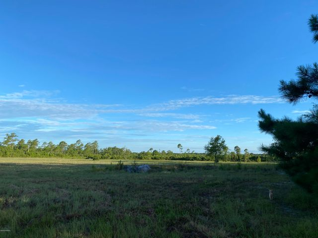 25 +/- acres for sale with stock ponds!  Located near Hwy 172 gate to Camp Lejeune. Partially cleared land for residential or recreational use.  Call for more information today!