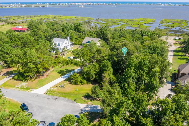 Stunning 2 Acre Waterfront Lot located in a cul-de-sac in the Premiere Gated Neighborhood of Mimosa Bay! Build your dream home with a private boat dock in the #1 sought after community in the area which boasts over 300 acres of lakefront, marsh front, and heavily wooded home sites with access to the Intracoastal Waterway. Mimosa Bay amenities include a community pool, tennis courts, clubhouse, gated entry, fitness center, playground, picnic area, boat launch, boat corral, and day dock. Perfectly located only minutes from Topsail Beaches, MARSOC, Camp Lejeune and just between Jacksonville and Wilmington. Enjoy the Salt Life!