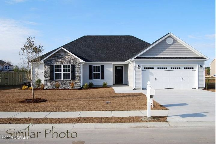 Welcome to Jacksonville's hottest new community, Stateside. Located off of Gum Branch Road behind Stateside Elementary School. All new construction by Onslow County's most trusted and preferred Builder featured in Builder 100/ Top 200 Home Builders in the country. Stateside is 16 miles to Camp Lejeune, 12 miles to New River Air Station and minutes to area schools and shopping. A beautiful new community for active and growing families. Introducing the Brookings floor plan which offers 4 bedrooms and 2 bathrooms at approximately 1673 heated square feet. Situated on a gorgeous lot with exquisite curb appeal! The exterior of this ranch-style home is just charming with easy-to-maintain vinyl siding, accented by brick or stone. All surrounded by a sodded front yard with a clean, classic landscape. The foyer invites you in, opening to the great room. At approximately 14'x20', the great room is large enough to gather the entire family for movie or game night. Cool off under the breeze of the ceiling fan situated on the vaulted ceiling or snuggle up next to the cozy electric fireplace, surrounded by marble and topped with a custom mantle. The chef in the family is sure to fall in love with the kitchen! Flat panel, staggered cabinets with modern granite counters, pantry, and stainless appliances. Appliances include a smooth-top range, microwave hood, and dishwasher. The open concept of the dining area is the ideal setting for family meals or entertaining. The master suite is sure to please with a ceiling fan and a luxurious master bathroom. Complete with two vanities topped with cultured marble counters, full view custom mirror, ceramic tile flooring, separate shower and soaking tub.....all leading to the walk-in -closet. Bedrooms 2, 3, and 4 are perfectly sized and prewired for ceiling fans. Separate laundry room makes chores easier. Entertain guests or enjoy those Carolina evenings on your large open patio. Protect your vehicles from the weather in your 2 car garage. All backed by a one-year builder warranty from a top, local builder. Call today! NOTE: Floor plan renderings are similar and solely representational. Measurements, elevations and design features, among other things may vary in the final construction. Call to verify. Buyer to verify schools due to a district rezoning. Upcoming community amenities will include clubhouse area and community pool. Welcome Home.