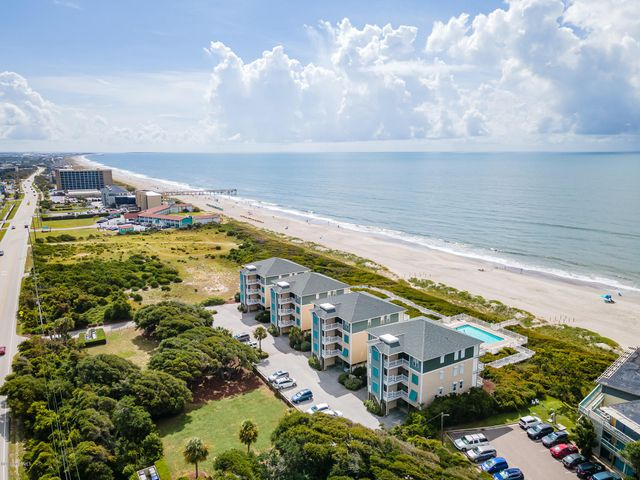 Oceanfront condo at Shutters on the Beach offering easy ocean access and the Country Club of the Crystal Coast across the street for golfing and social packages (see document in MLS).  Delightfully furnished condo with minimal exclusions that is a proven income producer of $35,000/year even with owners blocking a month! Two bedrooms and two full baths; an open living area with a fireplace, kitchen with a dining space and breakfast bar; outside decking for enjoying the ocean breezes. Ground level storage unit marked 101 for beach, pool and fishing toys! Shutters on the Beach offers a community swimming pool, building elevators and direct beach access. Nearby attractions: NC Aquarium, Bogue Banks Library, the Country Club of the Crystal Coast golf course, local shopping and dining.