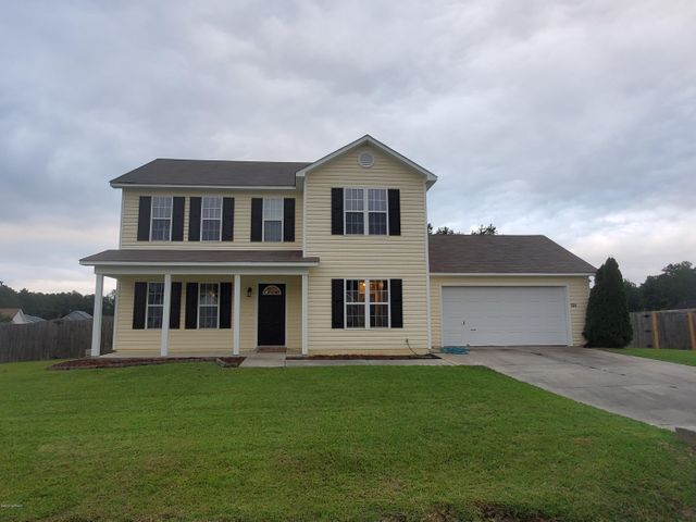One of Only a Few!!!  $1500 Buyer's Choice Allowance.  This 4 bedroom 3 bath home is  only 20 minutes from the Main Gate of Camp Lejeune and has no city taxes. This well maintained home is outside the city but only a short drive to all city amenities. This one has a lot of space, 1828 Square feet to be sure.  Once inside the front door, you will be in the large foyer, just to the left space for an office, sitting room, or play den and to the right the open dining room. The master bed and bath are a must see.  There is a tub AND a walk in shower. Not only that, there is a walk in closet with a window bringing in natural light. There are three other bedrooms also located upstairs.  This kitchen is open to the living area and views the expansive, fenced back yard, where there is a 120 sq ft deck, and a storage shed.  Call today for a personal tour.
