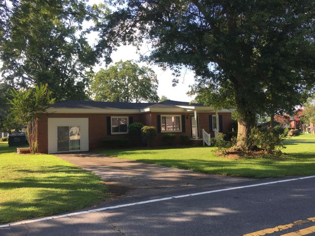 Brick single-family home with large trees close to shopping and restaurants. This 3 bedroom home has two full baths including one that is oversized with a new 42 jet walk-in American Standard therapeutic bathtub and a separate shower that is handicap accessible. The garage has been converted  (with separate entrance) that serves as the third bedroom and has an additional closet and large utility room that has hot water heater and air handler, laundry room  has entry from attached carport and provides room for your washer, dryer, freezer and still has room for the existing utility sink and ample storage  left. This house many amenities such as an attached two-car carport on the back of the house with access to the utility room, a roof and A/C unit are less than two years old. House is on .54 of an acre lot that allows for plenty of room for the kids to play, for RV/boat storage or add on space on the house. The house is conveniently located close to NC 24 Hwy , less than 20 minutes from I-40, and one hour to the coast, 30 minutes to Jacksonville home of Camp Lejeune Marine Base, 35 minutes to Goldsboro home of Seymour Johnson Air Force Base and 1 1/2 hour to Fayetteville home of Fort Bragg Army Base. Home needs new floor coverings throughout and the hall bath needs a tub valve installed.