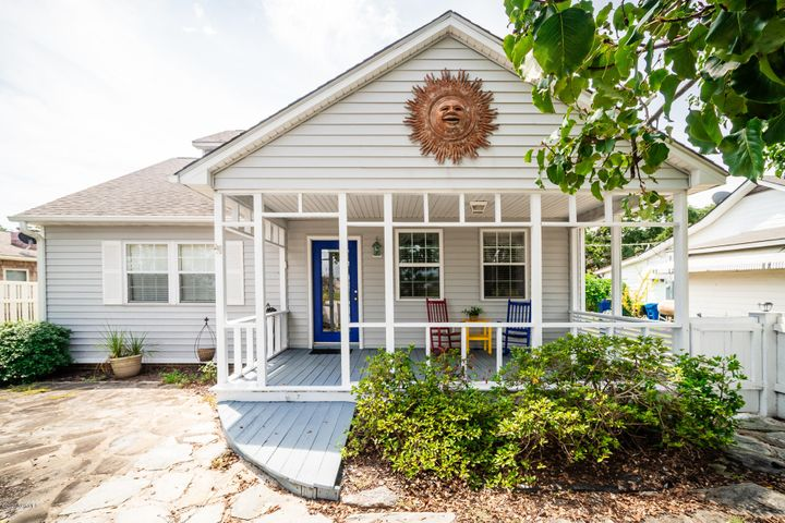 Charming, fully furnished, soundside home with updates that is just steps to Bogue Sound and a public sound access area. There is also a public boat ramp at the end of Evans Street that is within a short distance and this home is close to the Atlantic Beach bridge for easy access to the beaches! A large covered porch greets you into the spacious interior with an open concept living and dining area. There is a built-in bookcase in the living room for showcasing shells and treasures. Updated kitchen with white appliances, gas range, built-in microwave, dishwasher and tile flooring. There are two bedrooms, a laundry area and a full bath on the first floor. Upstairs on the second floor via the spiral staircase is a large bedroom with wood flooring, private bath and a large private deck looking towards Bogue Sound. This soundside home makes a perfect beach retreat or permanent residence on the coast!