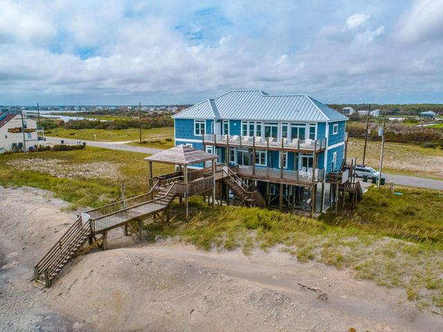 This custom built oceanfront beach home has been designed to comfortably accommodate 24 family members and loved ones.  Interior features include open airy floor plan, chef's kitchen and walls of windows to bring in the majestic ocean views. This home is located on one the most pristine and uncrowded beaches on the east coast, North Topsail Beach. The spacious floor plan of this gorgeous home provides ample room for entertaining your family and friends.  Expansive oceanfront decks allow for outdoor entertaining while enjoying the ocean breezes. This home offers the very best of Topsail Island oceanfront living.