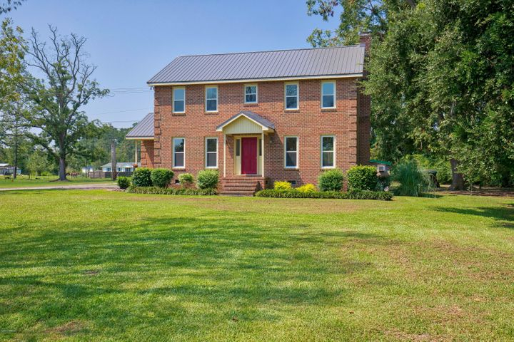WHOA! Hold your horses and stop the car! Need a place that will help support your hobby farm interests, master gardening skills, or just room to roam? Then this is it! Located between Jacksonville and Richlands, close to MCAS, Camp Lejeune, and only 5 miles to OAJ airport this beautiful 2-story brick home aims to please. The first level of this charming abode features newly finished hardwood floors that flow from the formal dining room to the spacious great room with a wood burning fireplace. The kitchen comes complete with brand new cabinets, new granite counter-tops and composite sink, and gorgeous new LVP flooring. The fully functioning utility room comes equipped with washer/dryer hook ups, bathroom, and new utility sink. The 2nd level boasts new plush carpeting and paint throughout, a large master bedroom suite complete with 2 walk in closets and a bathroom, 2 additional guest bedrooms with ample closet space and ceiling fans, and additional guest bathroom. To top it off, this home also has been fitted with updated lighting fixtures, all new windows, brand new metal roof, and an outside deck with customized air conditioned playhouse or dog mansion for your beloved canine companion! Best of all, there are NO city taxes or HOA. Hurry, this one won't last long so call today for your private viewing!
