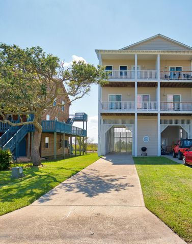 Outstanding rental potential and Amazing Water views from this 4 bedroom, 3 bath townhome in the serene town of North Topsail Beach.  Take an easy walk to the beach and come home to your own piece of paradise, far away from the crowds and traffic.  The location is a quiet cul de sac perfect for any family looking for a low traffic area.  Watching the boats on the ICWW is great and viewing the habits of the native waterfowl and wildlife from far above the marsh is interesting and entertaining.  Because of the height of the living area, views of the sunrises and sunsets are spectacular almost every day.  It is nice knowing that nothing can be built to obstruct the views.  The upkeep is less since the property is away from the beach and in general, the property may fare better during storms.  The family chef will love the kitchen layout designed for easy access and entertaining.  Decks front and back add room for relaxing outside and taking in the fresh salt air and breathtaking views.  The bedrooms are spacious and the open living area makes a great place for catching up.    This home has been exceptionally well maintained with love and care.  Excellent rental potential with very desirable setting.  Easy care flooring throughout and partially furnished for a head start in making this home your own.   Come take in the views.