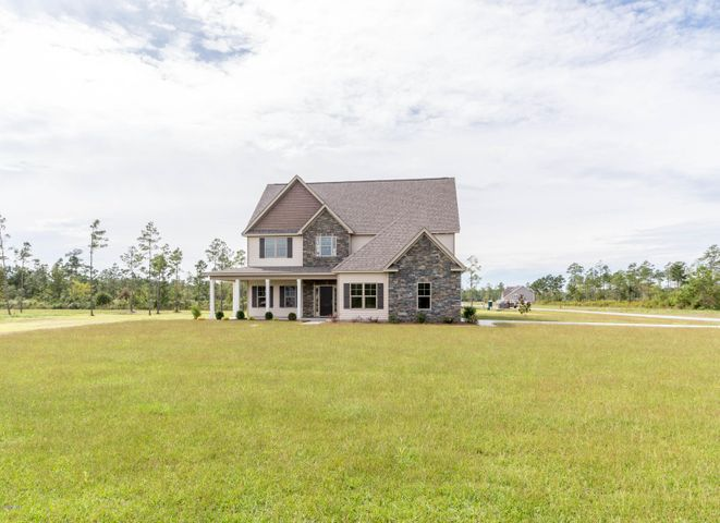 Introducing the ''Catherine'' floor plan at Hickory Bluffs! This new home offers 3 bedrooms with a bonus room, 2 full bathrooms, and a 2-car garage; at approximately 2,905 heated square feet! Located in a quiet country setting yet only minutes to local beaches, schools and shopping! Featuring architectural shingles, low maintenance vinyl siding, energy efficient heat pump, a sodded front yard, and professional landscaping. Interior features include designer inspired paint, flooring, lighting, cabinets and countertops. In addition, you will enjoy 9' smooth ceilings on the first floor, ceiling fans in the living room and master bedroom, plus stainless-steel appliances! Contact me today for more information!