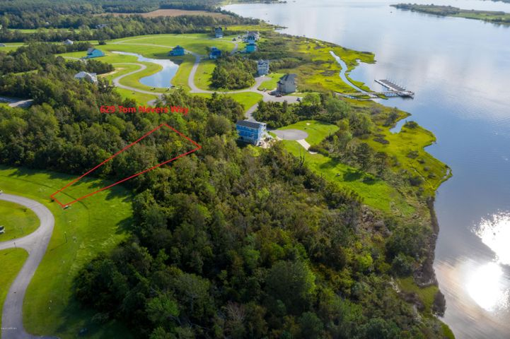 Great location in Summerhouse for you to build your dream home!!   Low annual HOA fees give you the opportunity to have access to LARGE pool, tennis,  pickleball, walking trails, fitness center, playground, beautiful   large clubhouse, day dock, boat ramp.  This lot is located to give you a view of Tom NEvers Pond and is off the main streets to offer a quiet area!  Life is good in Summerhouse! Call for more details today!!