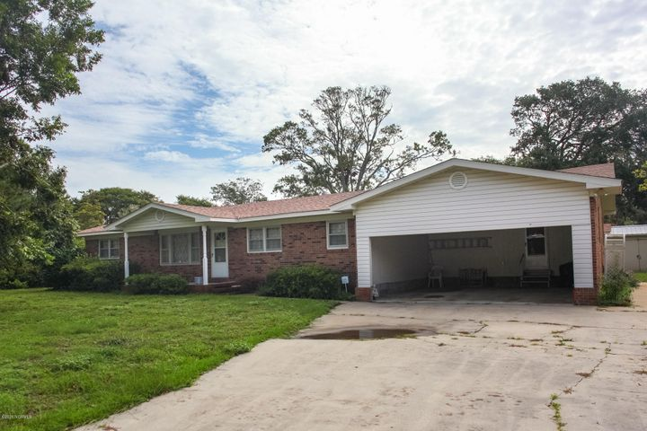 Rare opportunity to own this well-built & well-maintained brick ranch on a double lot, in an extremely convenient location on Oak Island. Offers a large 21x10 screened porch and storage building in back yard. House being sold as-is, needs cosmetic updating to make it your own home at the beach. New roof was installed in 2019. ***THIRD LOT (LOT#26) IS BEING SOLD SEPARATELY UNDER MLS#100234845. IF NOT PURCHASED BY SAME BUYER, WILL NEED TO HAVE SURVEY DONE AND RECORDED AT THE TOWN OF OAK ISLAND TO CREATE NEW ADDRESS & TAX ID.