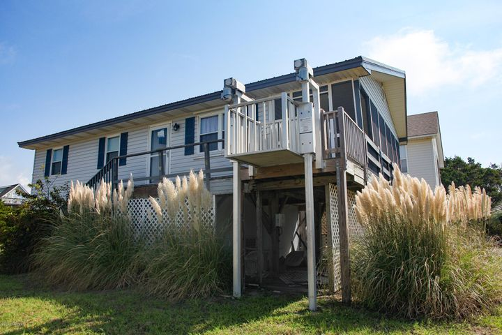 Come home to coastal tranquility in this stunning ocean view home nestled on the 2nd row in the private town of Oak Island! Take advantage of the convenient location of this property and enjoy a short walk home after a day on the water. Relax and enjoy serene ocean views from the comfort of your screened in porch. This wheelchair friendly home also offers an accessible elevator lift outdoors. This home offers an updated storm door and low maintenance LVP flooring. If you've been searching for the coastal lifestyle in a private setting, you owe it to yourself to see this home!