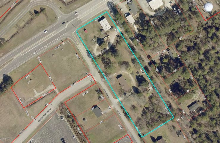 Apx. 3.28 acres of commercial land at corner of Hwy 55 & Galloway Dr & is across from Food Lion Shopping Ctr. Property is ideal for shopping center. Has old house & metal blding on property.