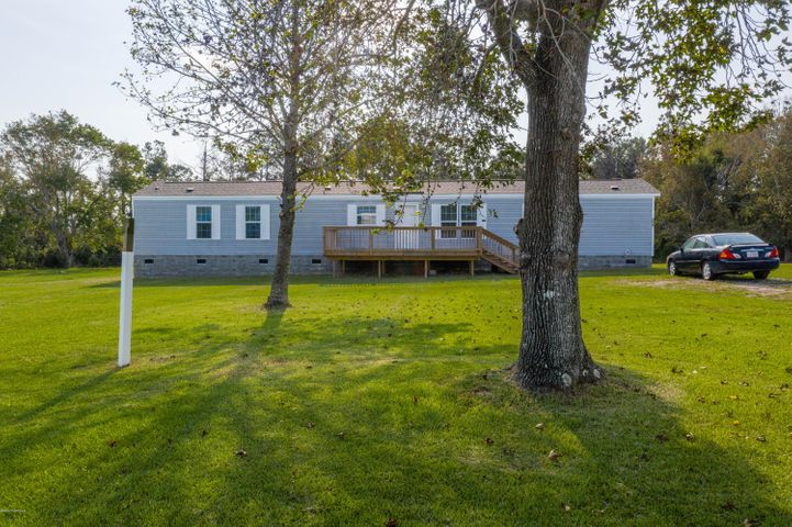 This is a beautiful one owner single wide and county has it listed on tax records. Has a partial fenced in back yard. Beautiful view of the ICW.