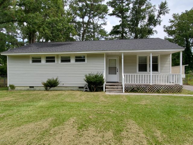 This is a wonderful starter home or investment property. Located in the heart of Jacksonville, minutes from base, shopping, schools, and restaurant. A large fenced in yard, deck, carport, and storage/workshop rounds out a perfect backyard space. This little gem, is a great find!