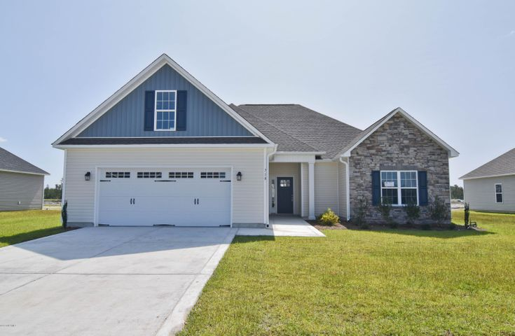 Welcome to the highly desired and popular community of Onslow Bay. Brand new construction built by Onslow County's most trusted and preferred builder, featured in Builder 100/ Top 200 Builders in the country. Onslow Bay is a hot spot, 3 miles to MCB Camp Lejeune's Piney Green gate, 14 miles to New River Air Station and minutes to area schools, shopping and dining. This beautiful neighborhood is sure to impress, complete with a clubhouse area and community pool. Introducing the Raegan 2378 floor plan. Featuring 3 spacious bedrooms, 2 bathrooms and a bonus room at approximately 2,378 heated square feet.  The exterior is quite charming with easy-to-maintain vinyl siding accented by stone or brick. All surrounded by a sodded front yard with a clean, classic landscape. The foyer welcomes you in, opening into the expansive family room. Approximately 25' x 18', the family room is perfect for gathering the entire family for movie or game night. Complete with a vaulted ceiling, ceiling fan, and an electric fireplace situated in the corner, surrounded by marble and topped with a custom mantle. The chef in the family is sure to fall in love with the kitchen! Flat panel, staggered cabinets topped with modern counters. Stainless appliances include a smooth-top range, microwave hood, and dishwasher. The spacious dining area is open to the kitchen. The master suite is located on the opposite end of bedrooms 2 and 3 for extra privacy. Approximately 17'x15', the master bedroom boasts a ceiling fan, trey ceiling, and his & her walk-in-closets. Unwind after a long day in the luxurious master bathroom. Double vanity topped with cultured marble counters, full view custom mirror, ceramic tile flooring, separate shower and soaking tub. Bedrooms 2 and 3 are complete with walk-in-closets and prewired for ceiling fans. Enjoy those Carolina evenings on the covered patio. 2 car garage. All backed by a one-year builder warranty from a top, local builder. Call today! NOTE: Floor plan renderings are similar and solely representational. Measurements, elevations, and design features, among other things may vary in the final construction. Call to verify. Welcome Home.