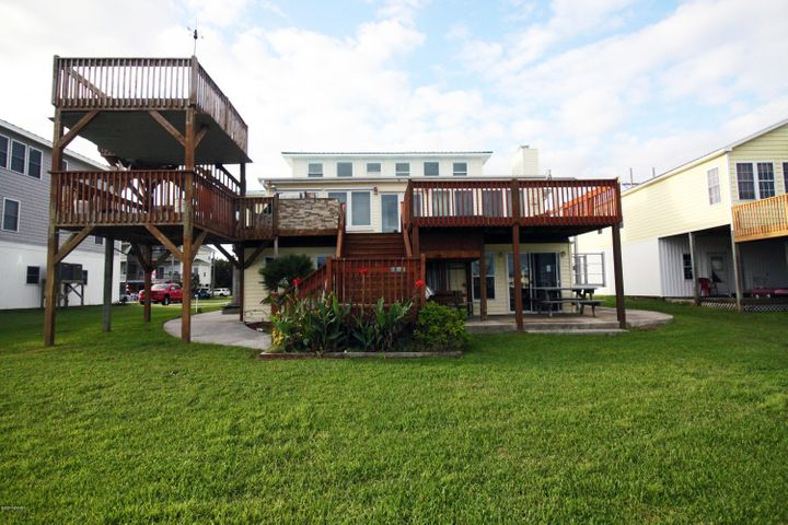 This beautiful updated intracoastal waterfront home offers Breath taking views of the ICWW and Topsail Island. Located towards the end of a quiets street, Private with dock two boat lifts and two slips,, large, open multilevel decks, with hot tub and outdoor built in grill area, , an elevator, enclosed sun room, bonus room on the top level with amazing water views, additional finished space downstairs with 2nd kitchen and bath, extra rooms not counted in the sq footage, , lots of storage, and two car garage this one is a must see!