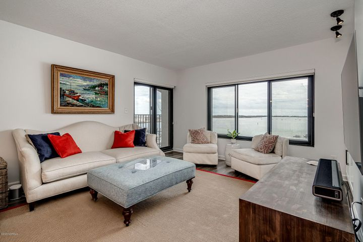 Dockside unit offers breathtaking views of Bogue Sound, the ICW, Sugarloaf Island & the Morehead City waterfront. Updates include: LVP flooring, quartz countertop, cabinets refaced and opened up to living area, decorative ship lap, carpets, repainted, light fixtures, 2016/17 appliances. Partially furnished with an exclusions/inclusions list under documents.  Fabulous outdoor balcony to enjoy the amazing views curled up with a good book or with family and friends! Dockside amenities include: outdoor pool, indoor pool, fitness center, sauna, ground level storage, expanded cable, gas utility & secured building elevator.