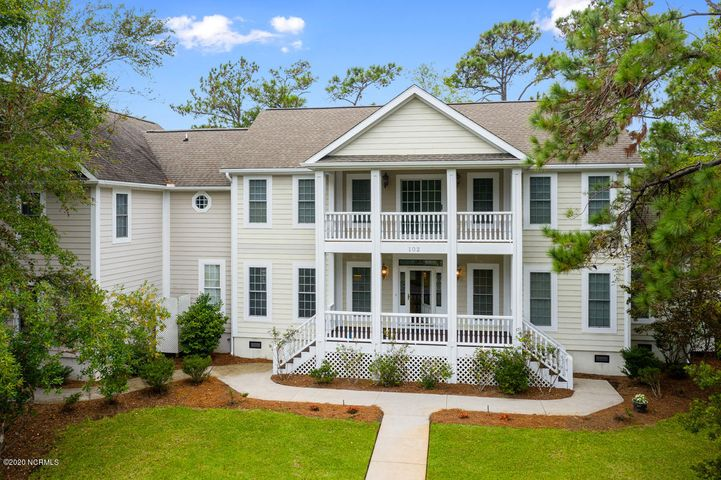 If you're searching for the coastal lifestyle with a flair of elegance, look no further than this gem in Caswell Beach! This immaculate 5 bedroom 4.5 bath property offers room for the whole family with over 3500 sq ft AND over 200k in renovations! Some of the many features of this home include beautiful Brazilian Cherry hardwood floors throughout, a first-floor master suite, and a spacious bonus room over the garage with lots of possibilities. Nestled in the highly sought-after community of The Arboretum in Caswell Beach, this home is just a short walk away to the many neighborhood amenities including a pool, tennis courts, golf course, as well as private community access on the beach. This home also features added garage space just for your golf cart! Come home after a fun day to the outdoor shower, and enjoy a cold drink on your back porch or upper-level balcony. This beautiful home won't last long, give us a call today before it's gone!