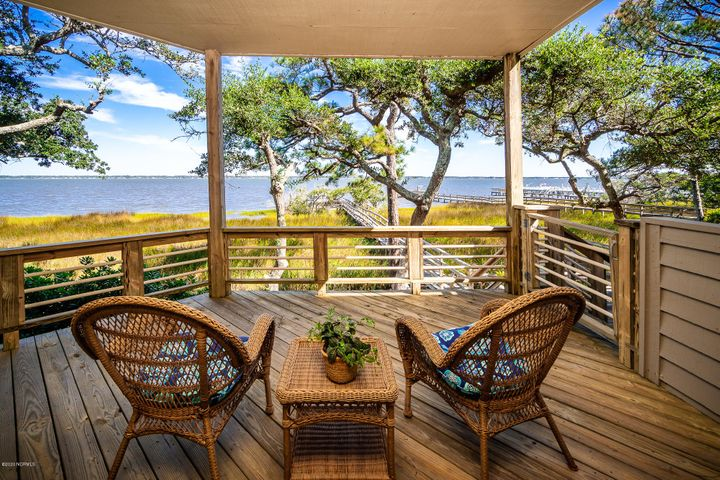 Beautifully UPDATED and FURNISHED, ground floor, soundfront condo nestled among the live oak trees in Fiddlers Walk and just a five minute walk to the beach access via private walkways! The ground floor location provides for ease of entry and the waterfront location offers amazing waterviews from the large covered deck overlooking Bogue Sound. Recent updates include: engineered white oak flooring in hall, kitchen, living, dining, master bedroom and master closet; quartz countertops in kitchen and baths; subway tile backsplash in kitchen; new refrigerator, microwave and range/oven; cedar shiplap added on back of kitchen and dining room cabinets; tile flooring in baths and tile in master bath shower; new sinks/faucets and lighting in kitchen and bath; new mirrors and baseboards in bathrooms; fresh paint in hall, kitchen, living, dining, master bedroom and closet -- please see the Special Features Sheet in documents!Versatile and functional floor plan with open concept living areas, 3 bedrooms and 2 full baths. Peace of mind: all insurance fees, except for interior contents, are included in the HOA dues! Beacon's Reach amenities include: 3 master association swimming pools, tennis courts, marina access, ocean and soundside access points, fitness center, walking and biking trails.PLEASE NOTE: the water has been turned OFF.