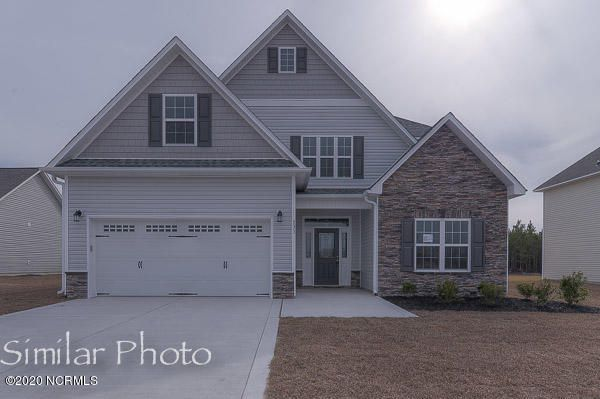 Welcome to the highly desired and popular community of Onslow Bay. Brand new construction built by Onslow County's most trusted and preferred builder, featured in Builder 100/ Top 200 Builders in the country. Onslow Bay is a hot spot, 3 miles to MCB Camp Lejeune's Piney Green gate, 14 miles to New River Air Station and minutes to area schools, shopping and dining. This beautiful neighborhood is sure to impress, complete with a clubhouse area and community pool.Introducing the Jade floorplan. 4 bedrooms, 3.5 bathrooms, approximately 2950 heated square feet. The quaint covered front porch opens into an impressive, long foyer. Add family photos and a warm touch of decor to welcome your guests. A spacious 17'x16' family room boasts a cozy fireplace. The 10'x12' kitchen opens to a vast 12'x15' dining room. This is the true center of the home. Kitchen appliances include a smooth top range, stainless dishwasher and stainless microwave. Enjoy entertaining your friends and family at dinners in this awesome space. The master bedroom and laundry room are both on the main level. The 14'x15' master bedroom is sure to impress with trey ceiling for an elegant feel. Accented by a ceiling fan. The 11'x13' master bath features a double vanity topped by a custom mirror, soaking tub, separate shower and a full 12'x7' walk in closet. A staggered staircase leads to the second floor into a 17'x13' loft or living room. This would be an ideal spot for the teenagers to hang out, hook up an Xbox or just enjoy a media room. A full bath is located off of this living room. Bedrooms 2, 3, and 4 are located on the second floor. Bedrooms 3 and 4 are considered Jack and Jill, sharing a full bath. The second floor also boasts a flex room with closet, 11'x11', that could be used as a 5th bedroom or playroom. There is also a 10'x12' study room that could be used as a workout room or home office. Space and more space. This floor plan is big and beautiful. This home also features a 2 car garage and a covered back porch. If you have a large family or just want a big house with great curb appeal and room to grow- check out this beauty. Quality new construction. All backed by a one-year builder warranty from a top, local builder. Call today! NOTE: Floor plan renderings are similar and solely representational. Measurements, elevations, and design features, among other things, may vary in final construction. Call to verify. Welcome Home.