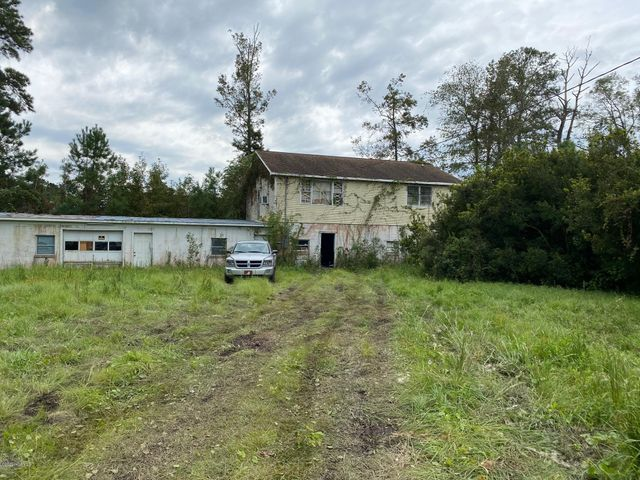 No city taxes. This property consists of 3 lots for a total of 1.34 acres. Homes are being sold as is and they may have asbestos in the structures.  Soil Inspection recently completed shows that current septic tank on land needs to be replaced. Property being Sold As Is.