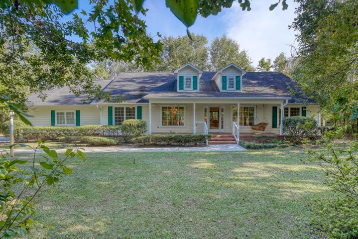Wow---what a rare find!  Welcome home to your private nature retreat in the middle of Hampstead with deeded water access and located in the Topsail School District!  Sitting on just over 4 acres in Olde Point Estates, you will feel right at home in this 3 BR, 3 Bath gem.  This truly is a nature lovers paradise and the rocking chair front porch is so inviting it screams southern living! Upon entering the home, you will find that the floor plan is perfect for entertaining. The kitchen acts as the central hub to the other living spaces-the dining room, family room and a flex space off of the back of the house. Gorgeous new LVP flooring has recently been installed throughout the living spaces, new carpet in all of the bedrooms and upstairs bonus room, and a fresh coat of paint on all of the walls.  Storage space is plentiful in this home which includes a very large walk in attic off of the upstairs bonus room.  Other noteworthy features include: a commercial generator, a 3 car garage with plenty of storage for tools,  a gardening space out back with a utility sink, a spacious sunroom connecting to the back porch overlooking a serene natural setting, and a circular driveway in the front of the house for easy access to the property and additional parking spaces.  Not to mention, Olde Point residents have deeded access to the boat ramp at Harbour Village and are able to access the ramp for an annual fee of $250.  Olde Point Country Club is also located nearby, and offers memberships for golf, tennis, and pool.  Don't miss the opportunity to make this your next HOME!