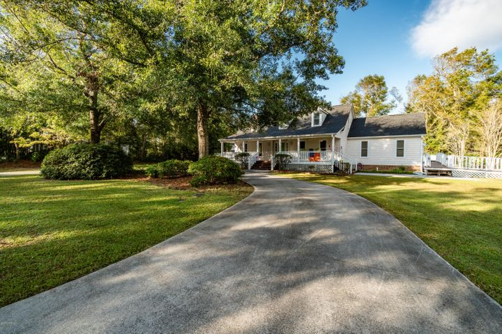 This Beautiful Waterview Home Will Not Last Long! Stunning Home in the sought-after Hunting Bay neighborhood. This community is spectacular waterfront community with a private boat ramp, and day dock, taking you right out to the ICW! Coastal living in the Carolinas, Location Location.... This BEAUTIFUL home features 4 bedrooms, 4 baths, and a bonus room/in-law suite. Walk into an impeccable space filled with natural light.  Large kitchen with granite countertops, stovetop, double oven, built in microwave and undercounter glass beverage cooler. Spacious Master bedroom upstairs with three closets, Master bath has two vanities, and tile floors. The backyard shows off the beauty of the Carolinas with a large fenced in backyard, separate driveway, great for boat storage, and so much more! Pictures say it all, but even better to See in person!! Come check it out today.