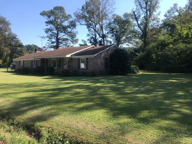 Investors alert! 35 acres of mostly cleared farm land with older brick home and storage building, just outside of Beulaville. All of this land is high and dry, with more than 800 feet of road frontage on Hallsville Road and more than 1,600 feet deep. Excellent farm land, or could be used for a new housing development. No town taxes!