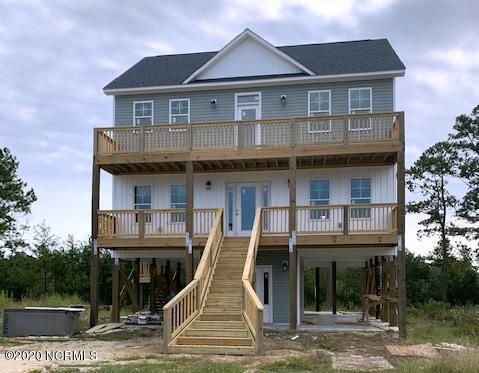 NEW Construction 2 story home (on pilings with ground level) on the waterfront of Little Northeast Creek. The journey through this home begins on the ground floor with a double carport, an outdoor shower, plenty of storage, and a wet entry way leading to the stairs (or upgrade to an elevator!) which will take you to the next floor up. The 2nd floor is meant for relaxing. There are front & back porches to sit and relax, enjoying the fresh air while winding down before heading off to sleep in one of the three large bedrooms. You have your choice of the Master suite with walk-in closet, shower, dual vanity and water closet or either of the 2 additional bedrooms joined by a Jack-and-Jill dual vanity bathroom with tub. The laundry room and linen closet are also conveniently located on this floor. Ready to visit with family and friends? Take the stairs up to the top floor where you'll find an open plan living area, dining area and kitchen. Perfect for entertaining, indoors or out as this floor also has a large front and back porch. Take in the views while enjoying your meal or drinks with your company! Did you receive an extra overnight guest? There is an extra bedroom located on this floor with access to another full bathroom and shower. Rather keep the visitors to a minimum? This room would be perfect as a home office, too. Whatever your intentions, this home has the perfect location, space and versatility to be your home sweet home. Picture shows a metal roof; however the home will be built with shingles.Builder reserves the right to make changes to floor plan/construction materials.