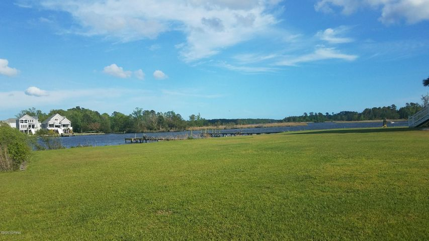 Beautiful high building site in exclusive  Laguna Bay!  Very quiet,  river view. Not in flood area.  Water & Sewer Tap included.