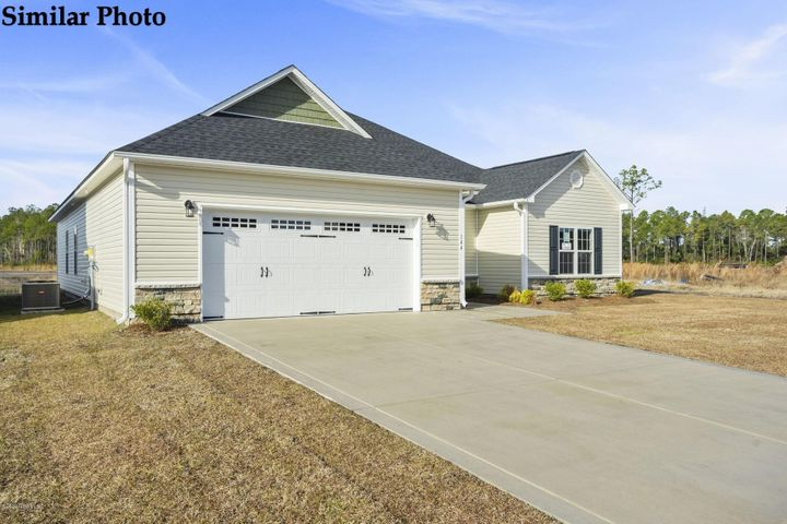 *Builder is offering $5000 in Use As You Choose! Welcome to the Raegan at Oyster Landing, you're going to love this home! Come in from the covered front porch and enjoy this open, one level floor plan. The vaulted living room is huge and boasts a stunning corner fireplace. The great central flow leads right into the spacious dining area and the convenient kitchen with stainless appliances. You'll adore the tray ceiling and dual walk in closets in the owner's bedroom space. You're in comfort and style in the owners' bath with its separate soaking tub, stand up shower, and dual sinks. Cherish your privacy with the owners' suite all on one side of the living area and the convenience of the lovely laundry area right next to your suite. The second and third bedrooms are generously sized, each boast a walk in closet and they share a fantastic full bath. *Buyer to verify schools. All similar photos and cut sheets are representations only. Builder reserves the right to alter floorplan and features.