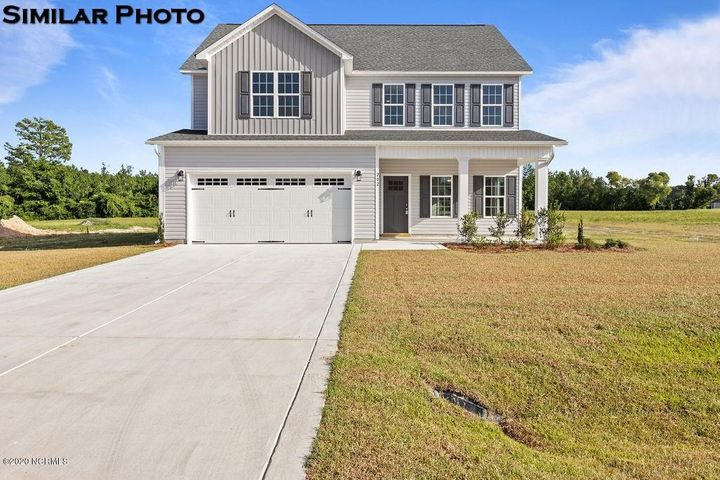 *Builder is offering $6000 Use As You Choose on this stunning home! Be one of the first to own a Marvin floorplan in Village Creek! This lovely 4 bed, 2.5 bath, 2 story home is just what you've been looking for and sits on a 1.17 acre lot! The covered front porch welcomes you in to the foyer. With the dining room to the side, and the spacious living room complete with a cozy fireplace straight ahead. The kitchen features gorgeous staggered cabinets, stainless steel appliances, a large pantry, and an eat in breakfast nook area. Upstairs you will find the owner's suite boasting a tray ceiling, huge walk in closet, and a lovely en suite bath. The other three bedrooms are all big and share another nice full bath. The laundry room is also located upstairs for convenience. Make your appointment today to fall in love with your new home!  *Builder to grade and seed up to 75 feet behind house as a normal backyard. Buyer to verify schools. Room dimensions and heated square footage may vary. Builder reserves the right to alter floor plan and features. Photos and cut sheets are representations only.