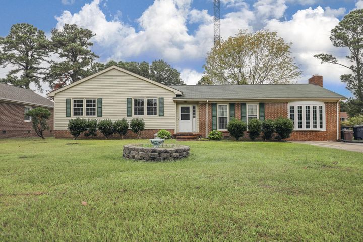 This truly unique MOVE-IN READY Jacksonville home is now available. Features include 3 beds, 2 full baths, large eat-in kitchen, and family room overlooking the huge bonus room. There is wood flooring in the eat-in kitchen and tile in the kitchen, foyer and bonus room. The kitchen comes complete with all appliances and extended bar for extra seating. The bonus room is just off the kitchen and family room and contains a large brick fireplace, crowd molding and a laundry closet with washer and dryer hookups. The large master bedroom includes laminate flooring and a full bathroom newly renovated. The backyard space is fully fenced and includes a storage shed and nice sized deck off the back of the home. This property is perfectly situated close to everything in town and an easy commute to base, schools, shopping and the main highway. Schedule your personal or virtual home tour today. Homes are moving fast in this area so don't wait!