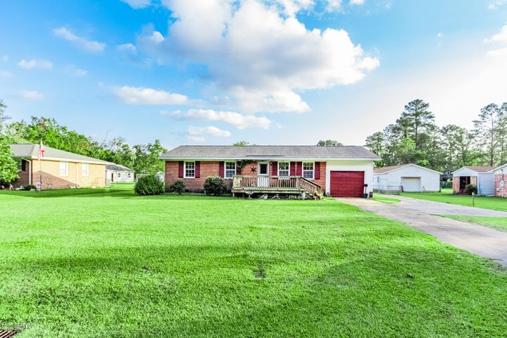 Charming country ranch home on a huge lot and a fenced in backyard! Split floor plan, 3 bedrooms, and 1.5 bathrooms, French- door to bonus room and back porch. The location is ideal for working on military bases, schools, shopping, restaurants and NO city taxes. Many possibilities come see today!