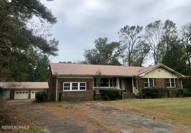 INVESTOR SPECIAL!!! Blank slate....over 1,800 SQFT! Home is situated on a 1.35 acre lot. So much privacy...you will love the location. 4 total garage spaces...2 attached and 2 detached. Home also includes a 3 car carport located in the back! So much to offer at the low price of $80,000. Don't miss out on this opportunity!