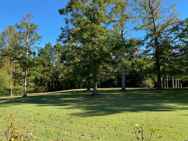 Beautiful Building Lot! Located in Country Club Acres. It is cleared and ready. The adjacent lot with almost 1,800 sq ft home is for sale also. 2 bed, 2 bath with Living Room, Family Room, Dining Area, Office and Laundry Room.